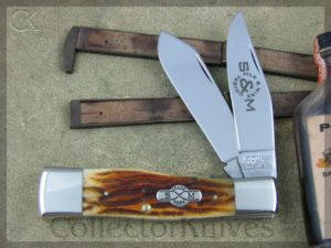 Schatt and Morgan Gunstock Jack Quart #O42104 by Queen, Gold Wormgroove Bone