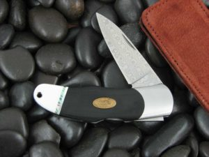 Moki Lockback with Black Linen Micarta handles MK207MEGE