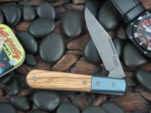 Lion Steel Shuffler Clip Jack Olive Wood Handles Blue Ti Bolsters Damasteel Super Dense Steel CK0112
